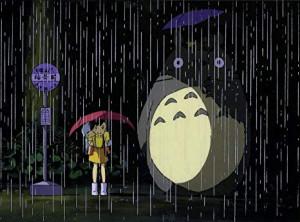 Satsuki prêtant un parapluie à Totoro